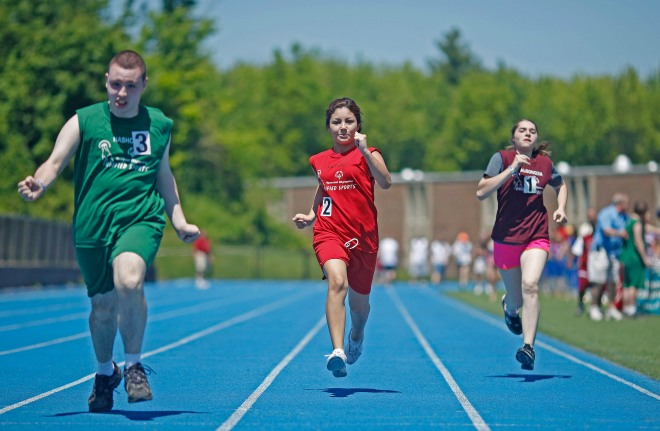 Athletes run in Special Olympics MA School event.