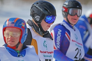 Gregg Gallant, center, skiing at the 2013 Special Olympics MA Winter Games.