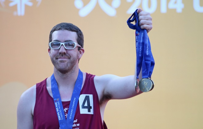 Daniel Williamson collects his team's Bronze Medals for the 200-M relay while the rest compete in individual events at USA Games.